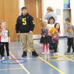 Kindergarteners at Beanbag Dribble Relay